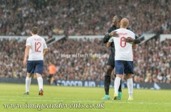 Manchester, England.10th June,2018.Usain Bolt and Wes Brown share a momentduring the Soccer Aid charity football match between an England X1 and a World X1. Each team of A-list celebrities and Sporting legends are fundraising for UNICEF.© Andy Gutteridge/ Image and Events/ Alamy Live News