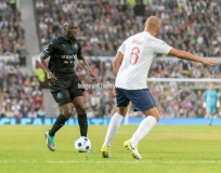 Manchester, England.10th June,2018.Yaya Toure and Wes Brownduring the Soccer Aid charity football match between an England X1 and a World X1. Each team of A-list celebrities and Sporting legends are fundraising for UNICEF.© Andy Gutteridge/ Image and Events/ Alamy Live News