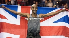 Mo Farah celebrates his victory in the 3000 mtrs at the Barclaycard Arena, Birmingham, England. The Muller Indoor Grand Prix.